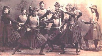 1880s Austrian women's fencing team poses in the fencing style of the day, using sword and dagger.