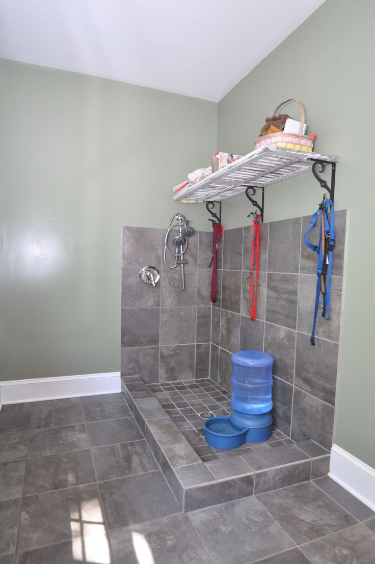 Mud room with dog bath.                                                                                                                                                      More