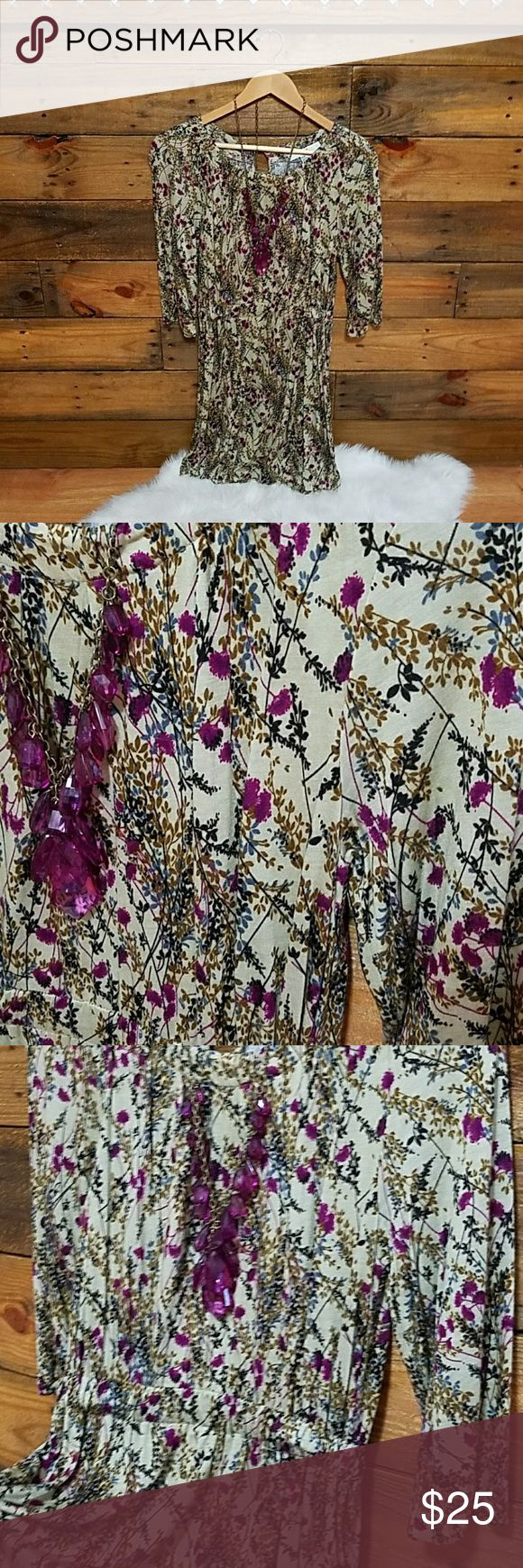 """Forever 21 floral dress Forever 21 floral mini dress with 3/4 sleeves, elastic waist. Size medium (I would say it fits a size 4 best). Approximately 34-35"""" length on hanger. Colors are best described as a creamy, light olive colored background with fuscia/purple/gold/black/blue floral pattern (see photos). Never worn, perfect condition. Super cute with thigh high riding boots. Forever 21 Dresses Long Sleeve"""