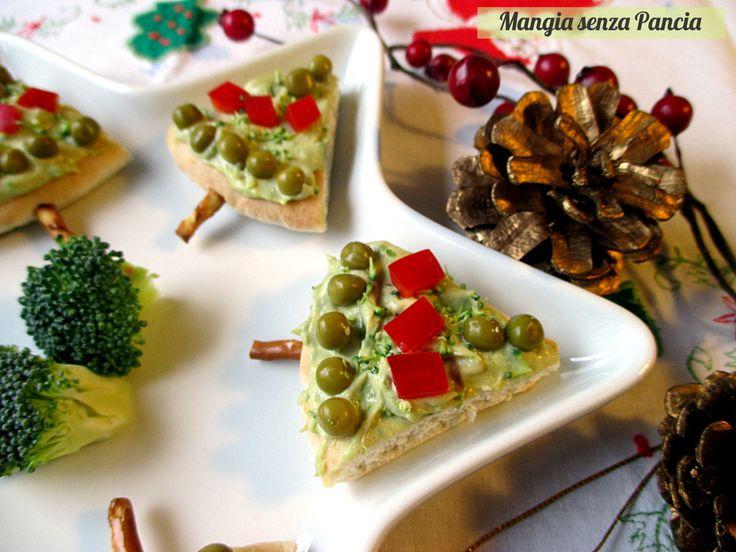 Degli sfiziosissimi alberelli di pane pita molto facili da preparare per il buffet natalizio, leggeri e anche nutrienti: per un Natale light!