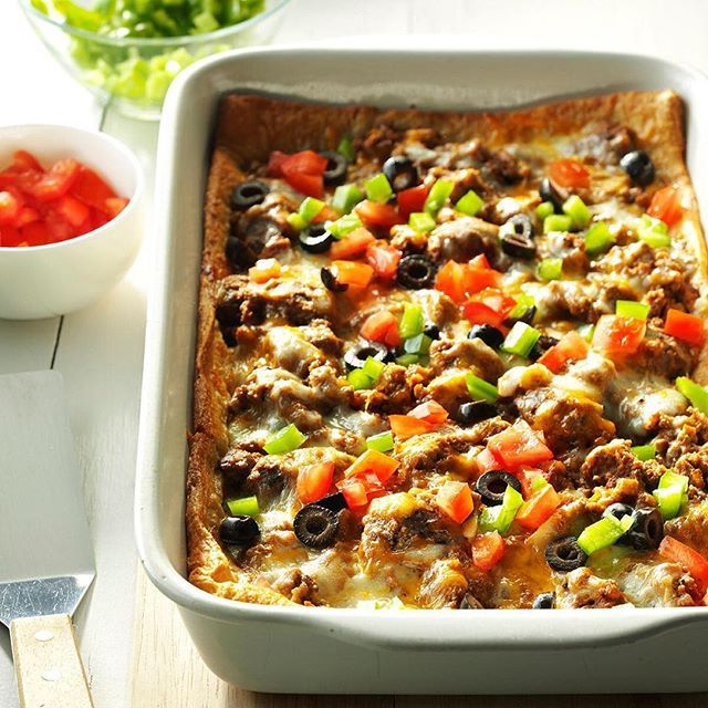 Burrito Bake Recipe  TOTAL TIME: Prep: 25 min. Bake: 30 min.    Ingredients  1 pound ground beef  1 can (16 ounces) refried beans  1/4 cup chopped onion  1 envelope taco seasoning  1 tube (8 ounces) refrigerated crescent rolls  1 to 2 cups shredded cheddar cheese  1 to 2 cups shredded part-skim moz...