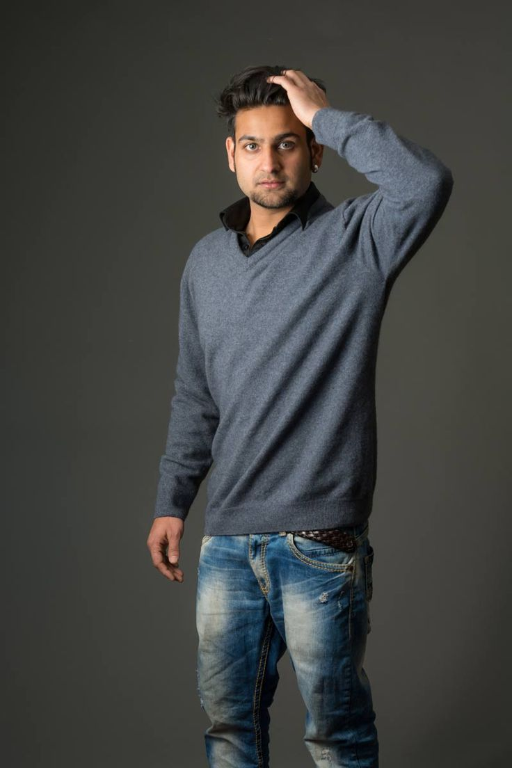 This new season plain men's possum merino sweater is a light weight knit and has a vee-neck that works well with a business shirt.  A luxury blend of 20% possum fur mixed with 70% merino lambs wool and 10% silk in light Sky Blue.