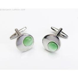 Off centre Green Cufflinks - A circular cufflink feature on off-centre green catseye dome.   Very unusual and eyecatching.