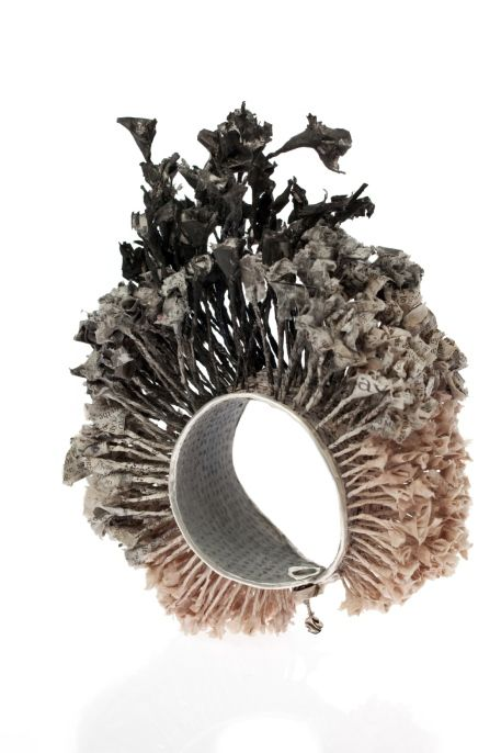 Bracelet | Sivan Alon.  Newsprint and silver.
