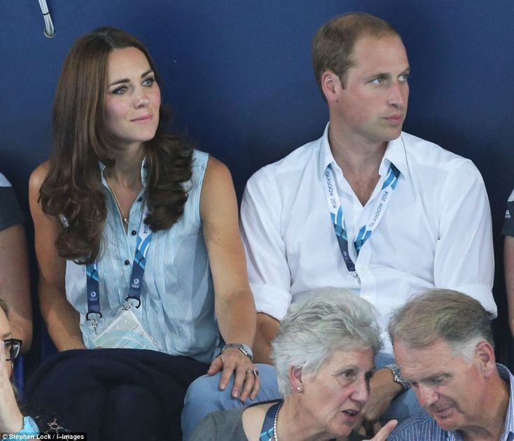 Kate was photographed clasped the hand of her husband Prince William before laying her hand on his leg (pictured) at the Glasgow-based event