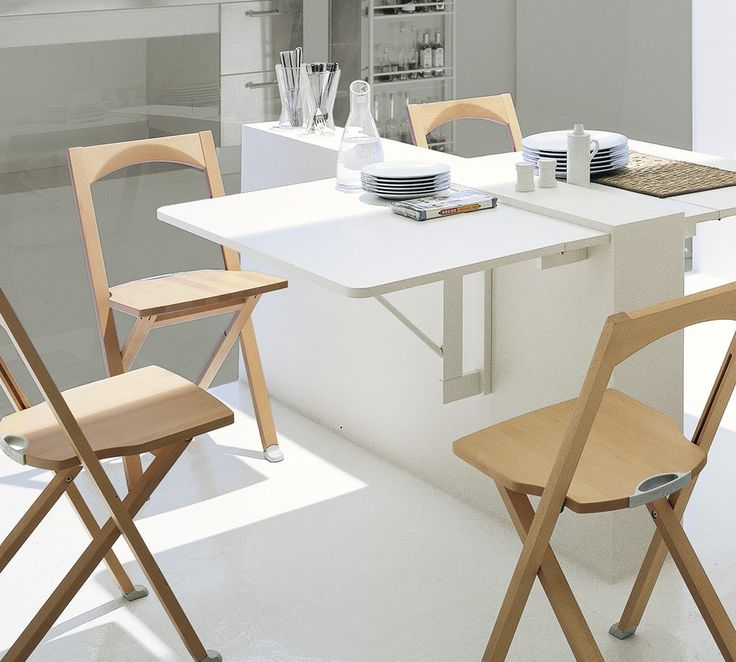 The Quadro contemporary folding table by Calligaris fixes to the wall with dowels. When collapsed the table protrudes only 14cm from the wall and, when extended, reaches 60cm in length. Available in matt optic white lacquer. Made in Italy.