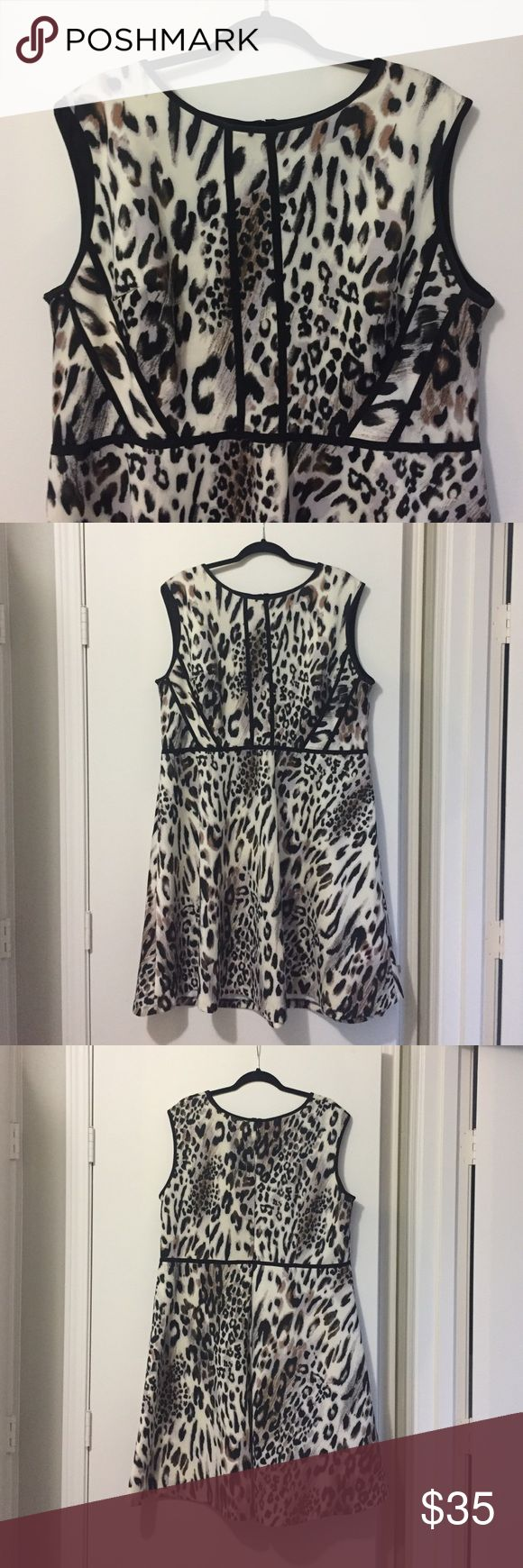 Wild Print Plus Size Dress Super flattering fun animal print dress. Great condition. Has some stretch to it so its comfy. Perfect for work or even going out. studio one Dresses