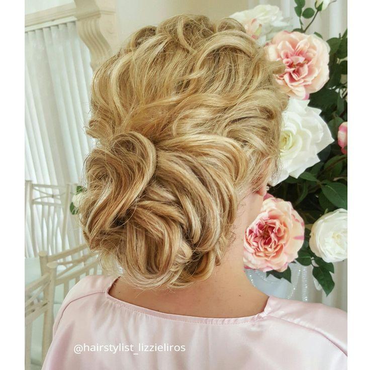 Bridesmaid's braided hairstyle by Lizzie Liros www.lizzieliros.com