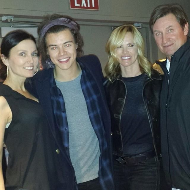 Harry with former professional ice hockey player Wayne Gretzky, wife Janet Gretzky and friend, backstage at The Eagles Concert at The Forum in LA.