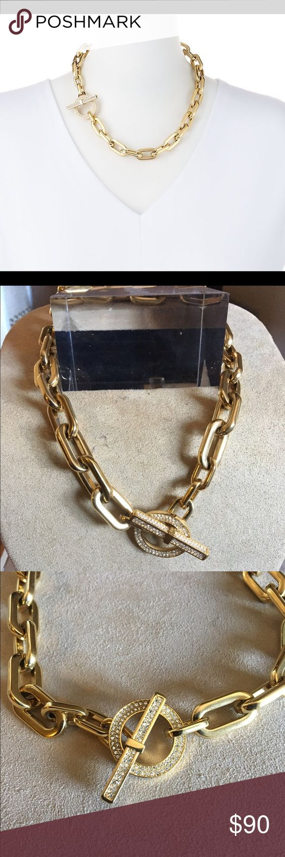 """Michael Kors Gold Pave Cityscape Link Necklace 18"""" Auth like new great condition - light surface scratches... Classic style with a glamorous twist. This gilded chain necklace is the kind of fresh yet elegant essential that partners perfectly with every outfit and instantly elevates the look. Its pave-embellished toggle provides just a hint of sparkle, finishing the design on a dazzling note.  Toggle clasp closure  Approx. Measurements: Length, 18"""". Width, 1/2"""" Michael Kors Jewelry Necklaces"""