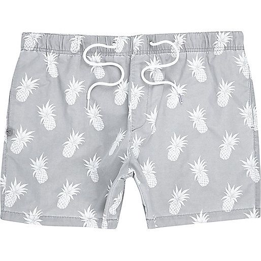 Make a splash on your next exotic getaway with these grey pineapple print swim trunks. Featuring an elasticated waist with a drawstring. Our model wears a UK M and is 185.5cm/6'1'' tall.