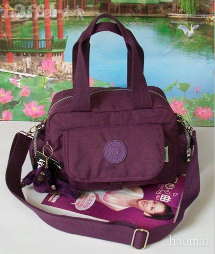 I love bags, love Kipling bags :-)  These are so cute.  All the little monkeys have their own individual names.