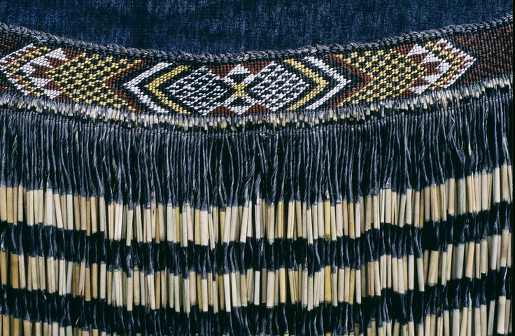 This image is of a piupiu(traditional Maori type of clothing) with a taniko(a form of weaving).