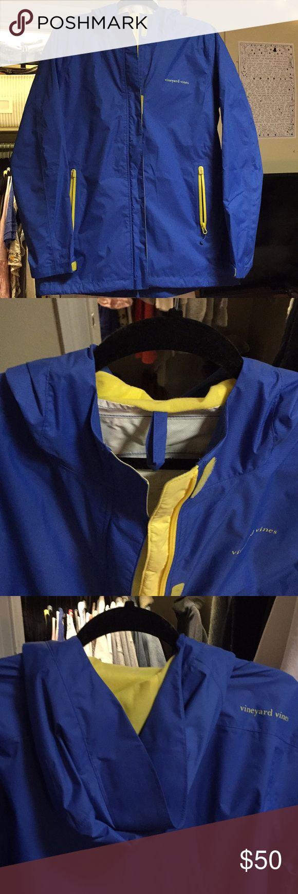 Vineyard Vines blue women's rain jacket EUC Classic stow and go jacket by VV women's medium. Pristine condition, only defect is that my name is written in sharpie inside at neck. Can easily be covered with a simple name sticker or scribbling out! Offers welcome Vineyard Vines Jackets & Coats