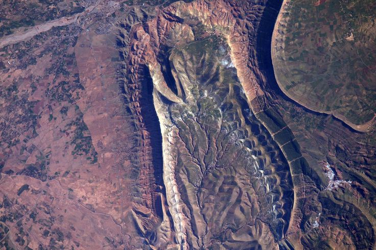 """Expedition 47 Flight Engineer Jeff Williams of NASA captured this detailed photograph from the International Space Station during a daytime flyover of Morocco on May 2, 2016. Williams shared the image to social media and asked, """"Reptile scales, or incredible and rugged geology in Morocco?"""""""