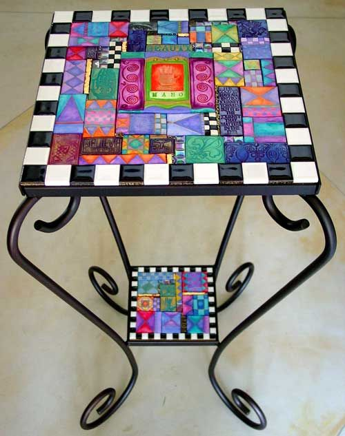 Love Laurie Mika's mosaics. The colors are wonderful - I think they're made of polymer clay tiles.