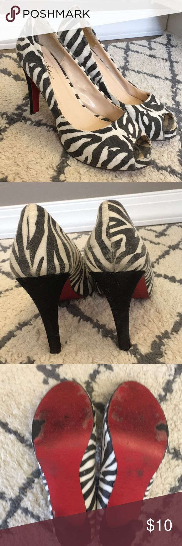 Zebra open toe heels with red bottoms Zebra print open toe heels with red bottoms. They are used but have lots of life left in them. Really comfortable! Ami Clubwear Shoes Heels