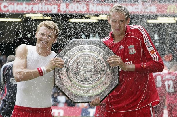 Liverpool goalscorers John Arne Riise and Peter Crouch pose with the trophy after beating Chelsea in 2006