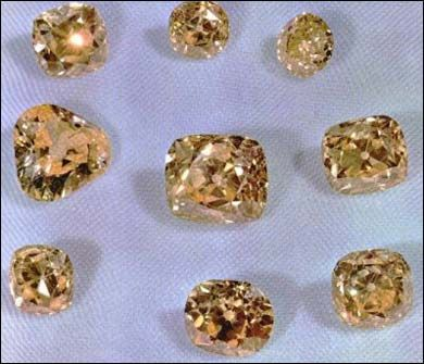 """The """"Iranian Yellows""""  These African diamonds were acquired by Nasseridin Shah on his third trip to Europe in 1889, and are collectively known as the """"Iranian Yellows.""""     There are a number of collections of large diamonds on display in the treasury, however due to security concerns, the largest of the diamonds in the collection are not pictured here.     The largest diamond shown here is 135 cts., while the largest loose diamond in this particular collection is 152 cts. Three other…"""