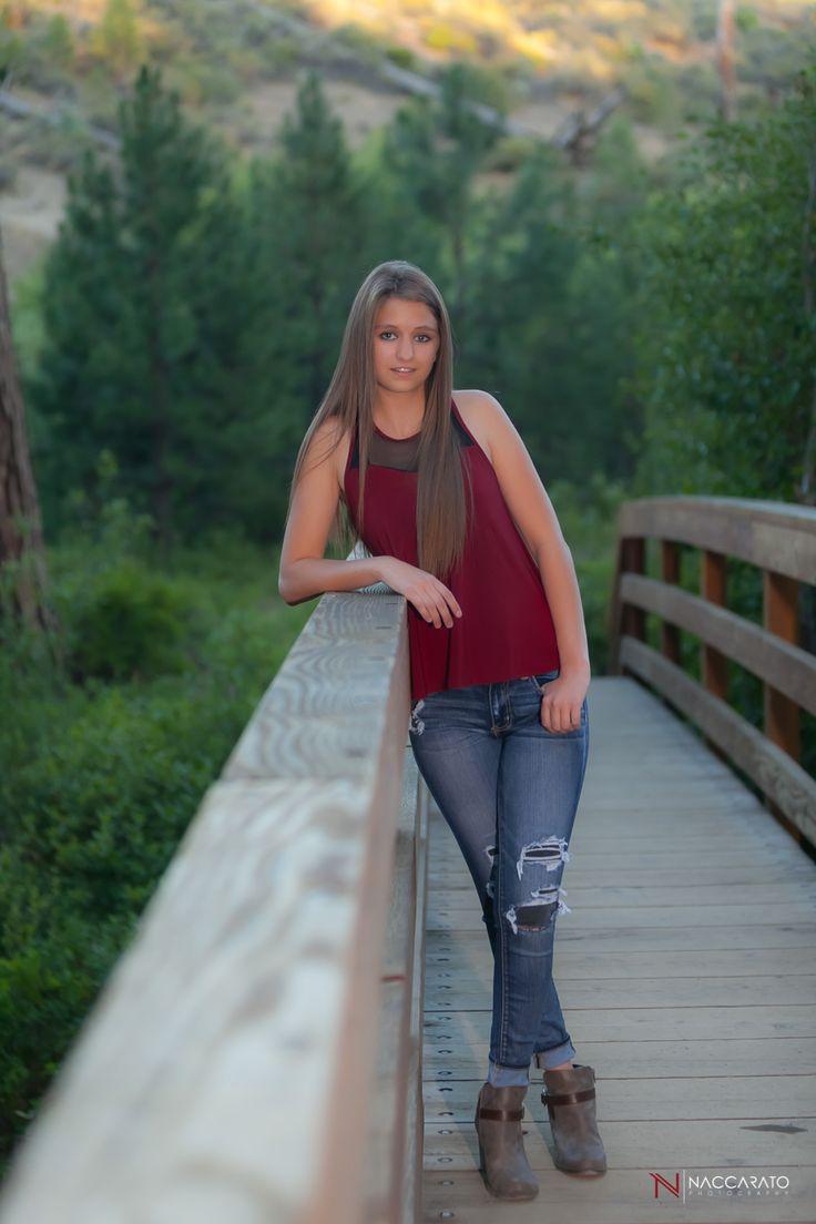 senior pictures on a bridge