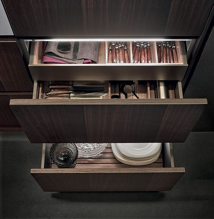 Varenna_Inner drawers with personalised front and equipment in walnut canaletto, inner led lighting system.