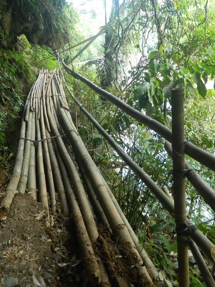 Bamboo bridge along rock face at Batu Katak
