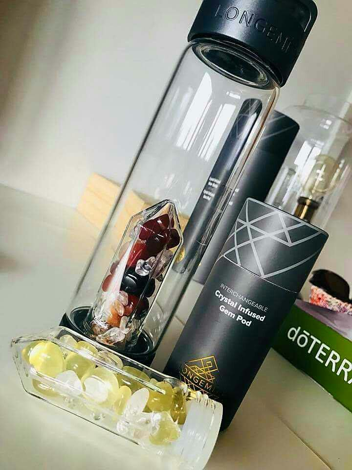 Longemity crystal drink bottle, with interchangeable crystal gem pods. Carry wellness with you 24/7 with holistic gem water.