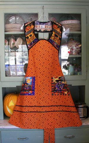 Retro Halloween apron, anything but scary.  The spiders on the orange gingham are darling. From www.stitchthrutime.com
