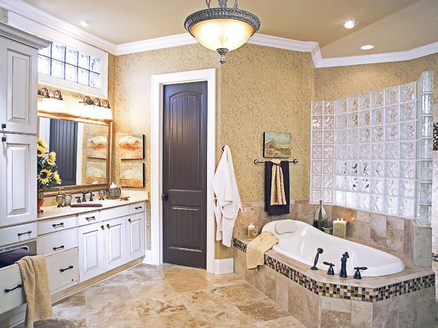 Designer's Notes  The extensive use of travertine marble, Old World cabinetry, glass blocks and glass tiles give this master bath a spa-like atmosphere. The double walk-in shower and the added feature of a warming drawer for bath towels complete the ambiance. Photo by Woodliff Photography