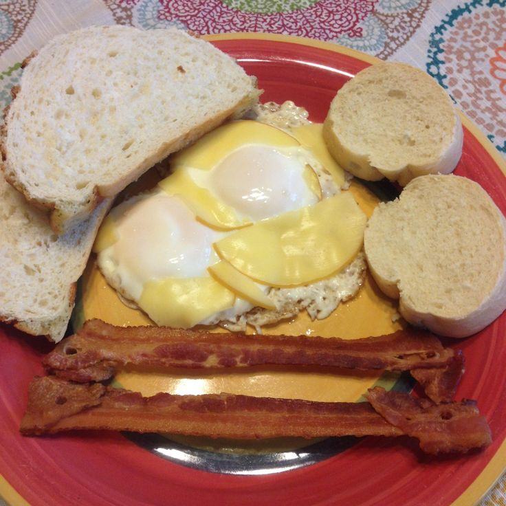 """[Homemade] """"The Classic."""" Twin butter fried eggs bacon French and Tiger bread"""