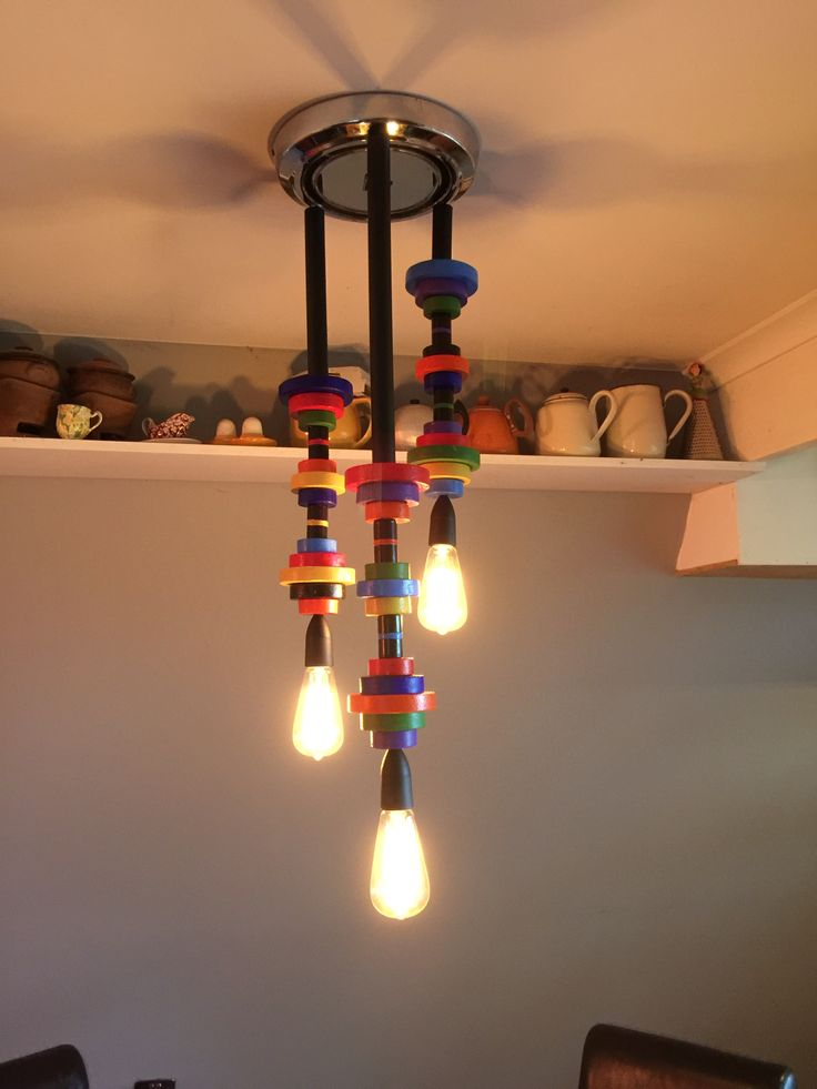Our funky dining room light. We used an old Holden hub cap for the base.