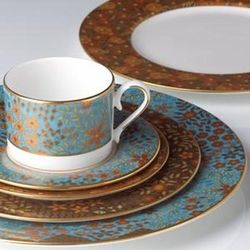 Gilded Tapestry is a striking pattern featuring a sky-blue rim decorated with a floral motif of salmon, rust, soft green and chocolate brown.  This is a richly textured pattern highlighted by gold trim and can be dressed up or played down to suit the occasion.  You'll love entertaining with this fine bone china set from Lenox.  Includes dinner plate, salad plate, bread plate, cup and saucer.