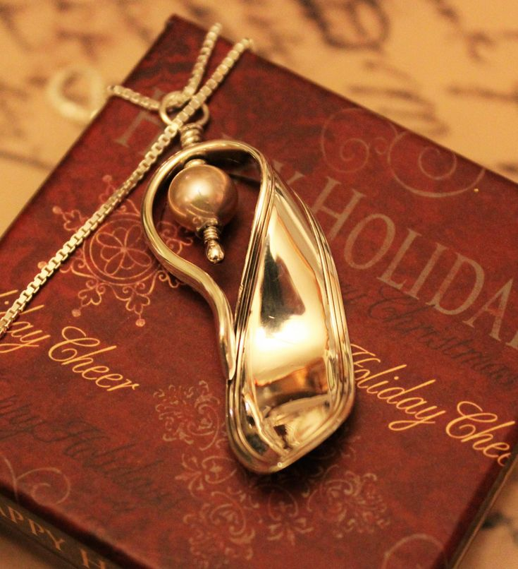 """""""Puritan"""" by International Sterling...circa: 1912...demitasse spoon fashioned into a Pendant w/ Blush Pink Cultured Pearl Nestled in Folds of Sterling Silver Ribbon...commissioned piece."""