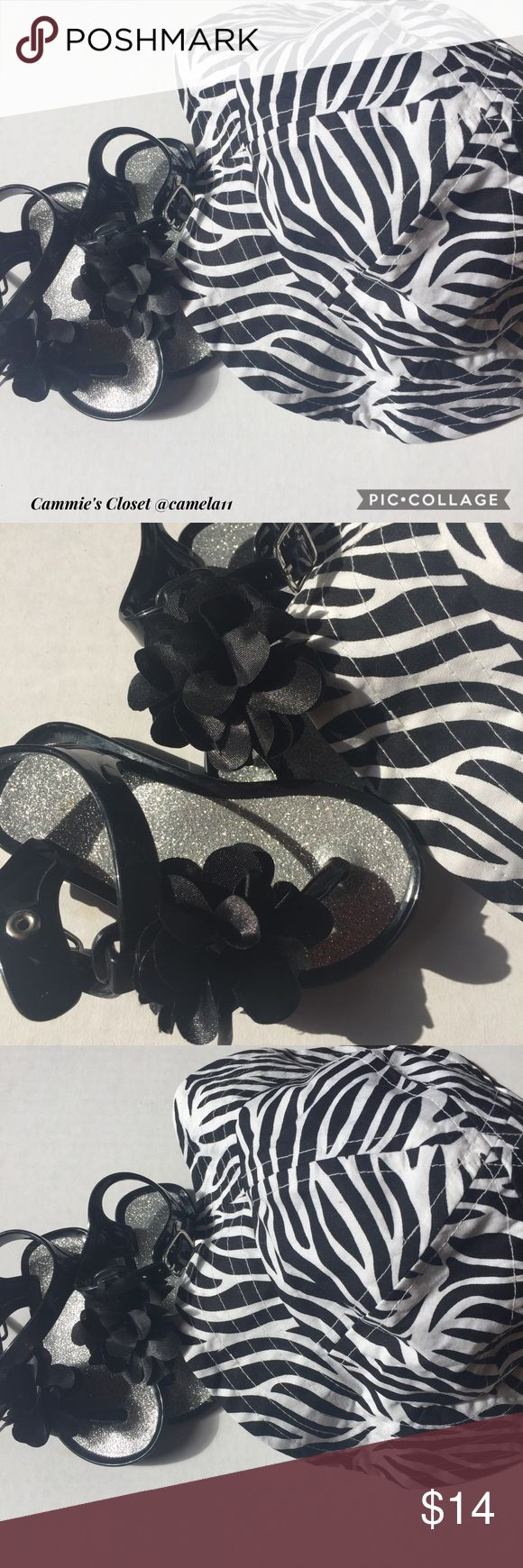 New listing! Infant black sandals and zebra hat! Cute black jelly sandals with silver glitter bottom; sandal goes btw toes; has black flower accent; sandals are a size 4; zebra sun hat size 2T, but fits any size below 2 years old.  Also available in my closet you will find jewelry, such as rings, necklaces, bracelets & earrings; make up, such as eyeliner, false eye lashes, lipstick & mascara; women's clothing, such as vests, sweaters, dresses, pants, jeans, bras & shirts/tops; kids clothing…