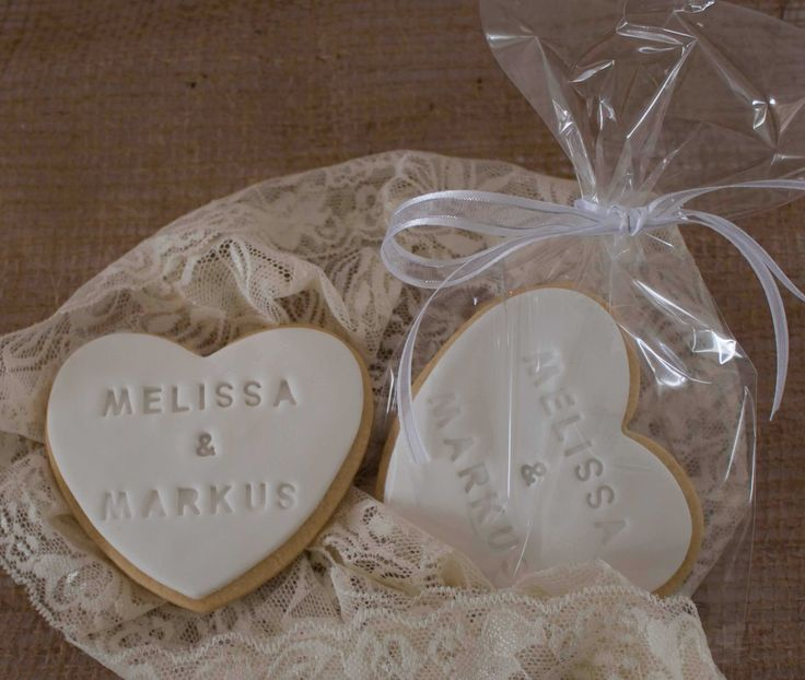Vanilla heart shaped sugar cookie with the bride & groom's names