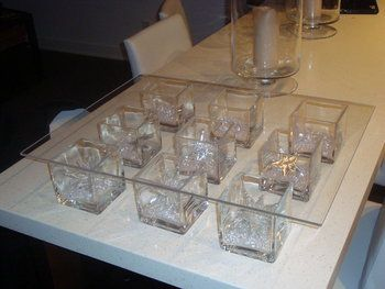 DIY wedding cake stand. This is actually a really good idea. square glass vases with a big square piece of glass and add your wedding decor to the vases!!!!