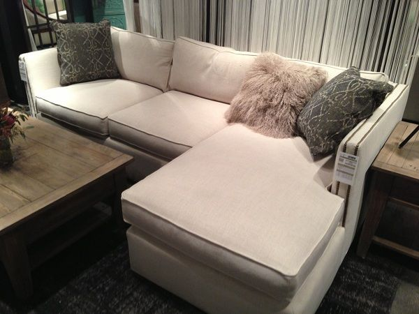White upholstered sofa by Four Hands Furniture. // www.KeyHomeFurnishings.com in Portland, Or