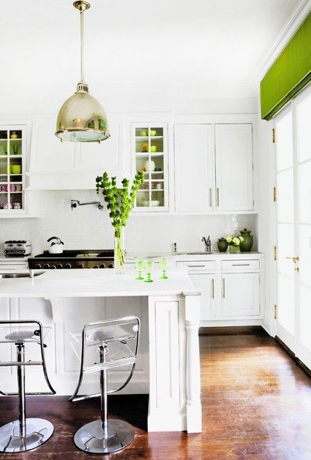 white kitchen with some bright green accents