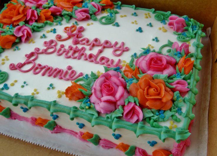 Buttercremeblumen auf einem Blattkuchen in Orange und in Rosa mit grünem Laub. www.f …   – Pretty