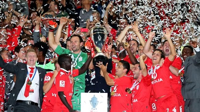 Adelaide United players celebrate their FFA Cup success.