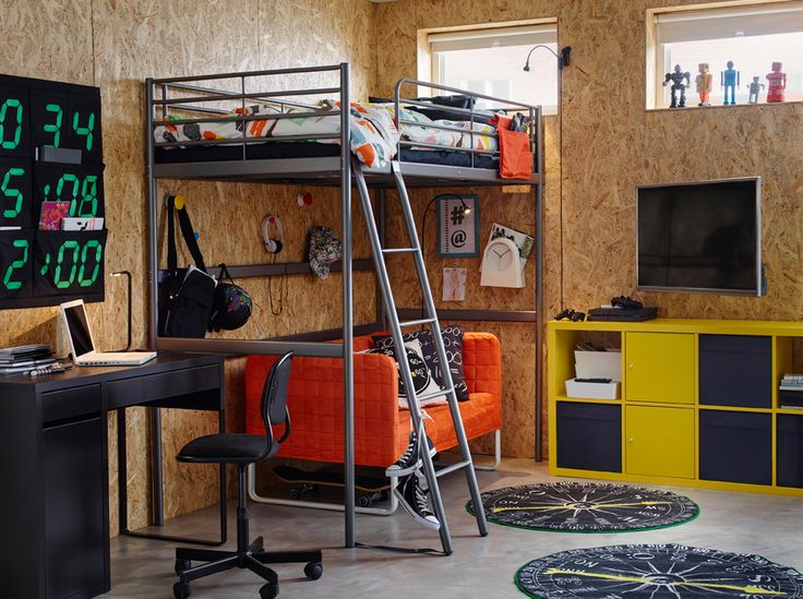 Colorful teenager's bedroom with particle board walls and metal loft bed.
