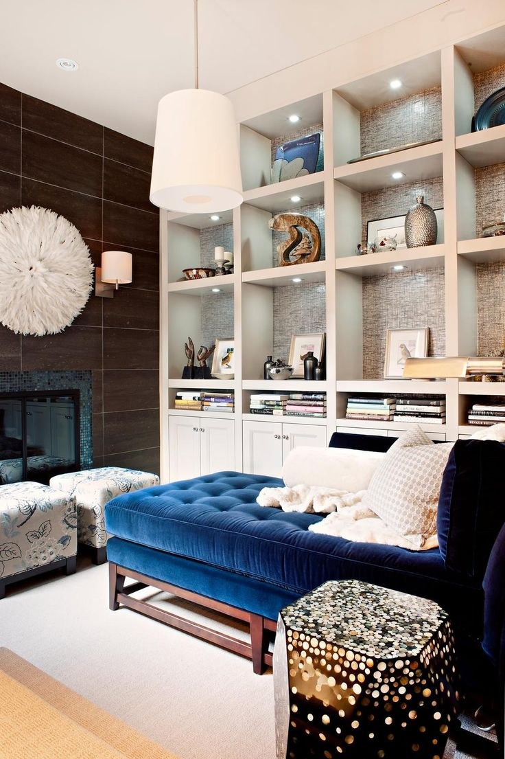 Contemporary Living Room Blue Sofa In Toronto With A Library And Tile Fireplace Surround