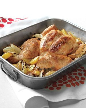 Spatchcocking -- splitting, then flattening a chicken -- yields a perfect roasted chicken in less time than a whole one takes. It also exposes more skin, which crisps up nicely at higher temperatures. Click here to learn how. Feel free to use a roasting pan or a large cast-iron or other heavy skillet.