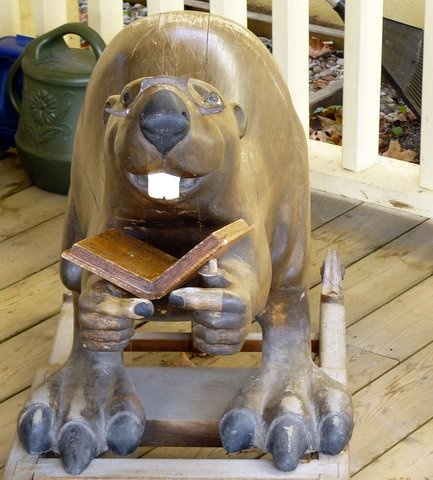 The Beaver Rocking Chair from Creemore Ontario. Looking a bit more beat up than he did in my day.