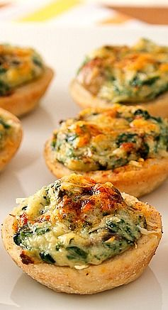 "Mini Crab, Spinach, and Mushroom Tarts  (Replace all crust ingredients with wonton wrappers and you cut fat and calories IN HALF!)  Make wonton ""cups"" by placing in a mini muffin tin and pre-baking at 350 degrees until golden."
