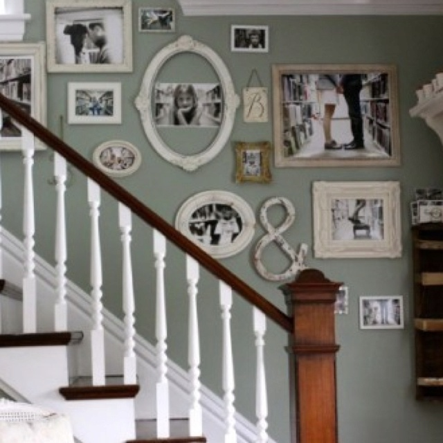 Really like the wall color with the antiqued white frames!