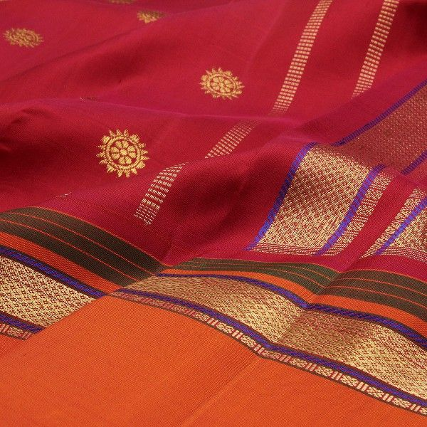 Arakku red #silk comes alive with a sprinkle of gold buttis and is teamed with a resplendent marigold orange border. Slender purple, bottle green and gold stripes add finesse to the border. The rich red pallu boasts of wide gold stripes, slender red stripes and slivered violet trims to create a rhapsody in silk. An Arrakku red blouse with running border adds the final touch of charm to this handwoven creation from #Sarangi. For saris in this exotic colour, visit Sarangi. Code 580125959.