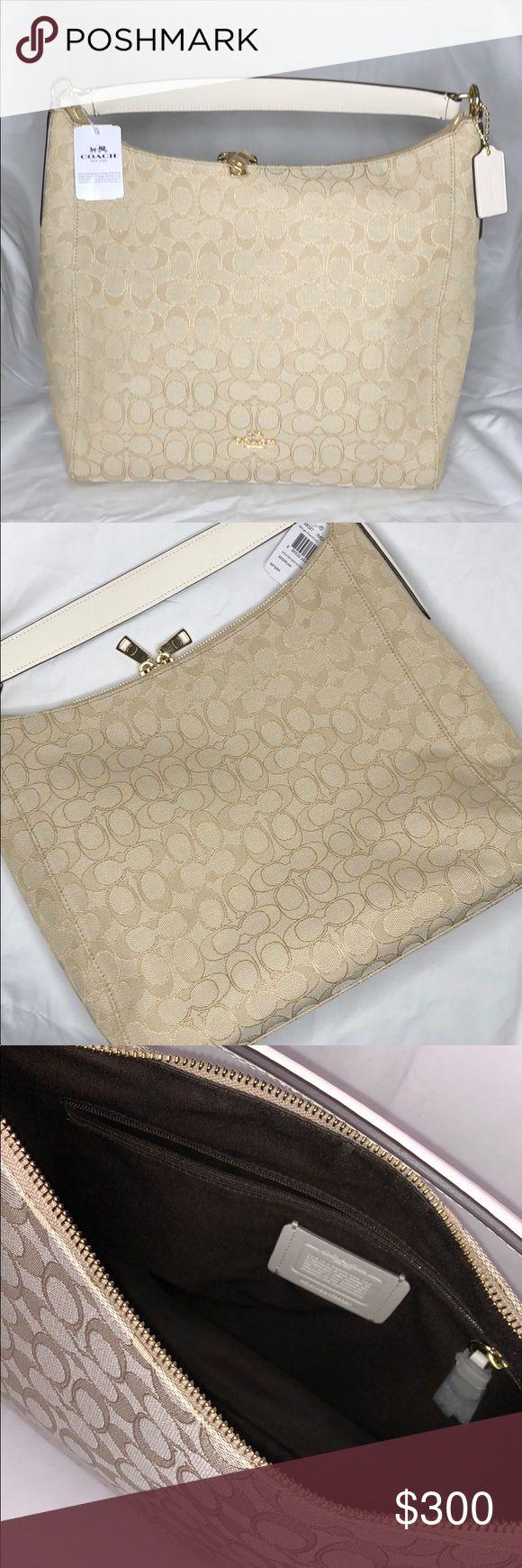 "NWT $375 COACH HOBO - LIGHT KHAKI NWT $375 COACH HOBO - LIGHT KHAKI   ✨A Gorgeous Coach Canvas Hobo Bag ✨New with Tag - Original Coach Box ✨Approximate Measurements  Length 12.5"" Height 13"" Width 5"" ✨GHW ✨White Leather Handle and Trim  ✨Interior large zipper pocket - slip pockets   ✖️no trade✖️ Coach Bags Hobos"
