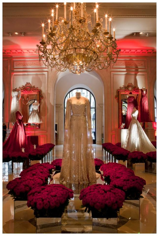 LIE SAAB celebrates the debut of Fashion Week with a spectacular exhibition at the Hotel George V in Paris. The Haute Couture evening gowns have been put on show like precious royal jewels, encircled with thousands of white and red roses.