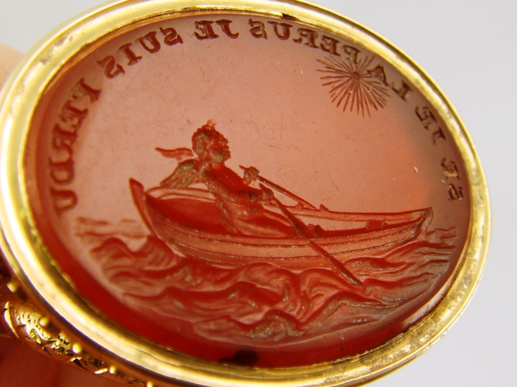 """Antique ring used for making wax seal impressions. The French inscription translates to """"If I lose you I am lost."""""""
